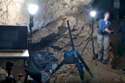 UC Berkeley professor Meg Conkey helps to shoot photogrammetry in the cave at Marsoulas.